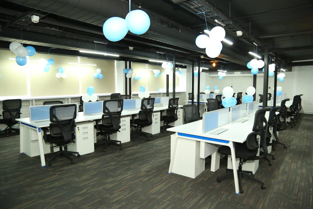 The large open-plan working space at MarketOne India''s new stylish office