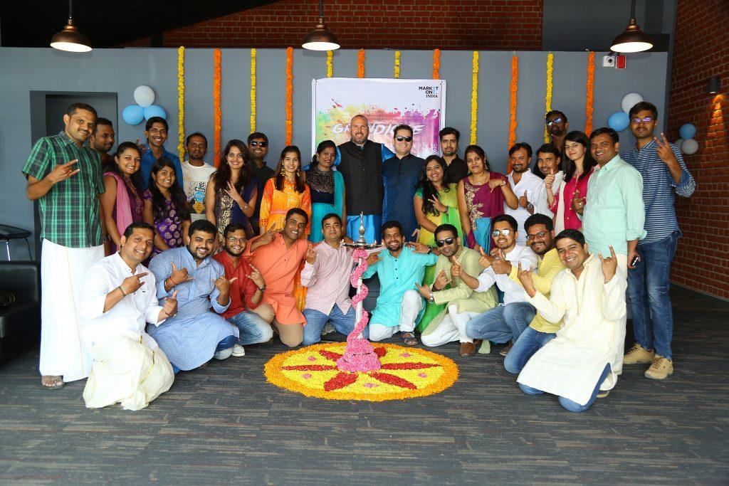 The MarketOne India team celebrating their stylish new office